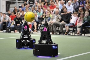 Middle Size League robots from Eindhoven University of Technology playing demonstration game.  Photo: Bart van Overbeeke