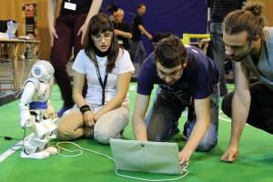 Italian team working on NAO-robot in Standard Platform League. Photo: Paul Bloemen